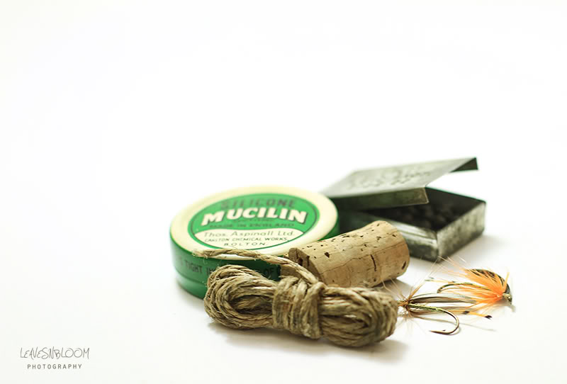 high key vintage fishing tackle in lightbox