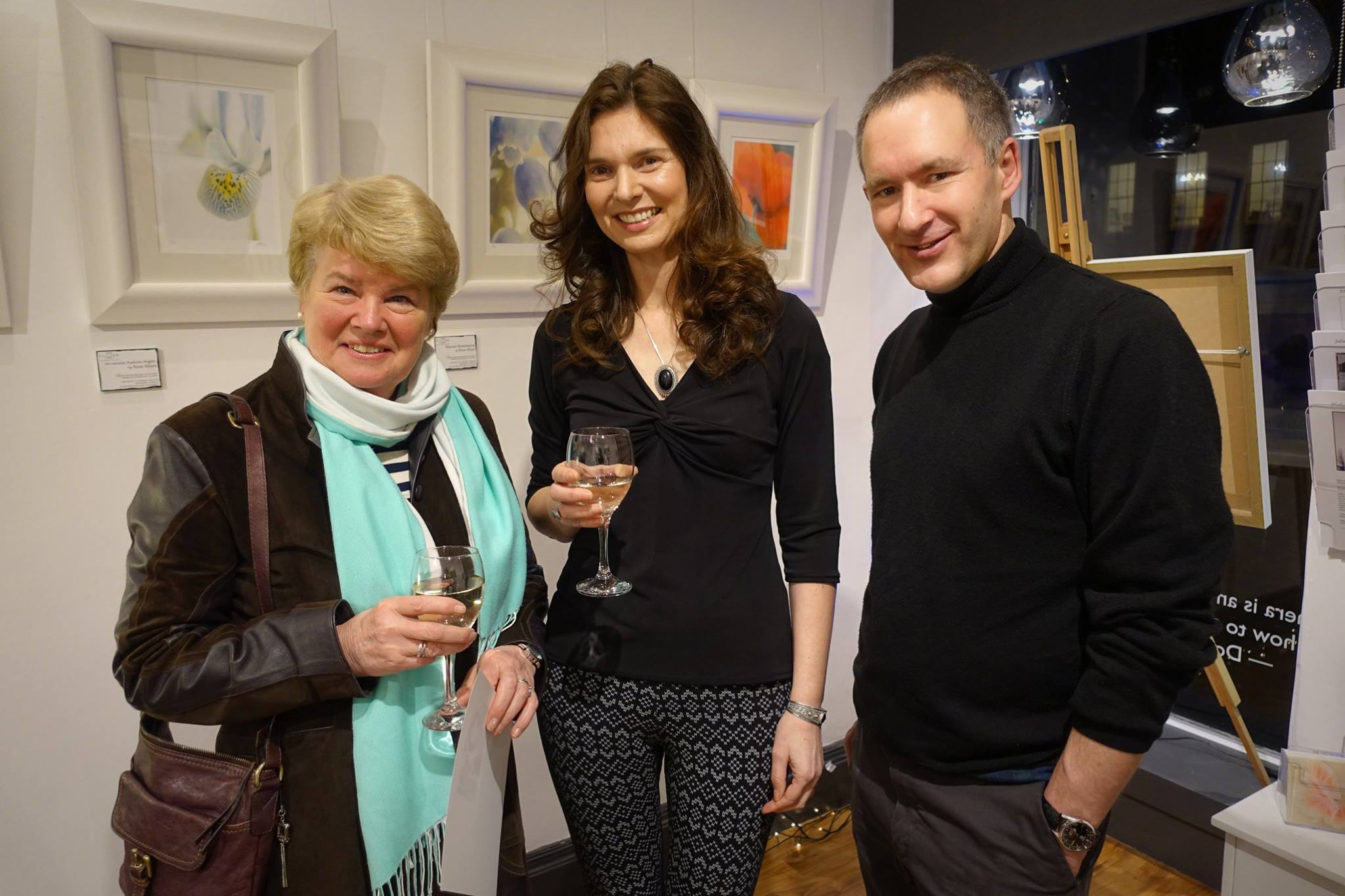 a photo of Rosie Nixon at her saying it with flowers exhibition with Lesley Watson former presenter of BBC Beechgrove Gardens along with Chris Close director of Gallery Close, Edinburgh