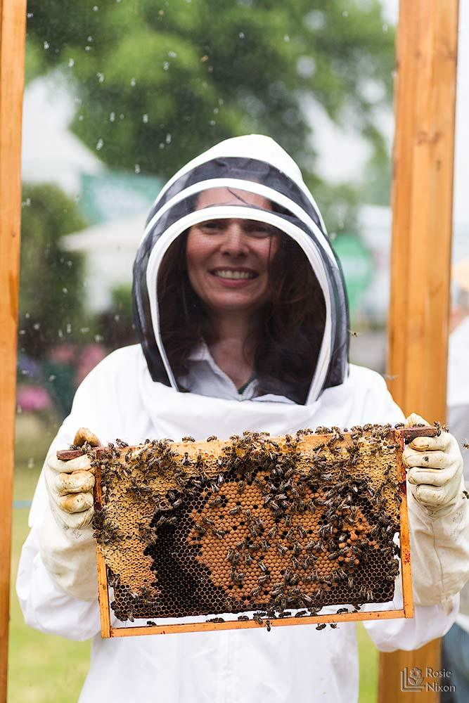 Rosie nixon flower photographer with bee hive frame - bee happy ayr beekeepers gardening scotland
